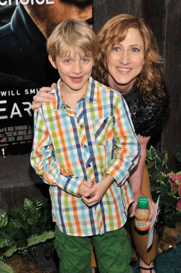 """NEW YORK, NY - MAY 29:  Actress Edie Falco (R) and son Anderson Falco attend the """"After Earth"""" premiere at the Ziegfeld Theater on May 29, 2013 in New York City.  (Photo by Stephen Lovekin/Getty Images)"""