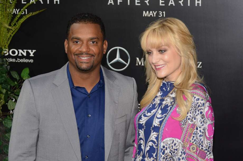 "NEW YORK, NY - MAY 29:  Alfonso Ribeiro and Angela Unkrich attend the ""After Earth"" premiere at Ziegfeld Theater on May 29, 2013 in New York City.  (Photo by Andrew H. Walker/Getty Images)"