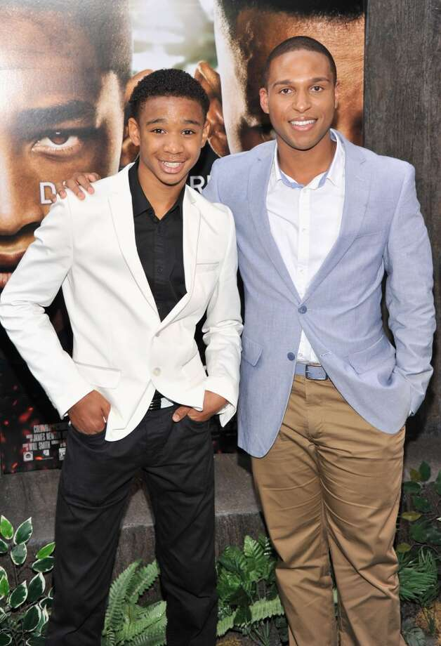 "NEW YORK, NY - MAY 29:  Darien Seaberry (L) and Louis Stancil attend the ""After Earth"" premiere at the Ziegfeld Theater on May 29, 2013 in New York City.  (Photo by Stephen Lovekin/Getty Images)"