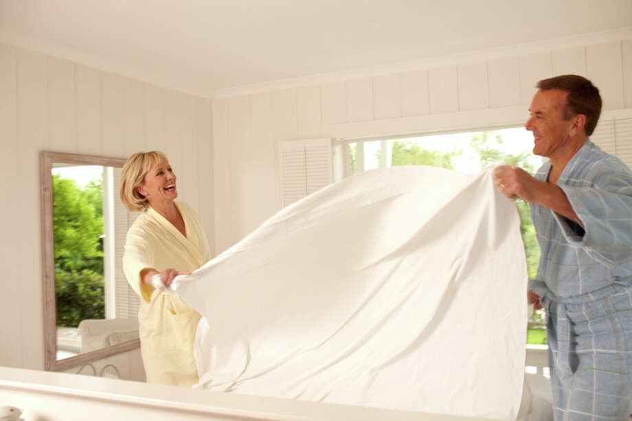 Bed sheets should be washed at least every other week.  If you sweat at night, wash your bed sheets weekly. Photo: Andrew Olney, Getty Images/OJO Images RF / OJO Images RF