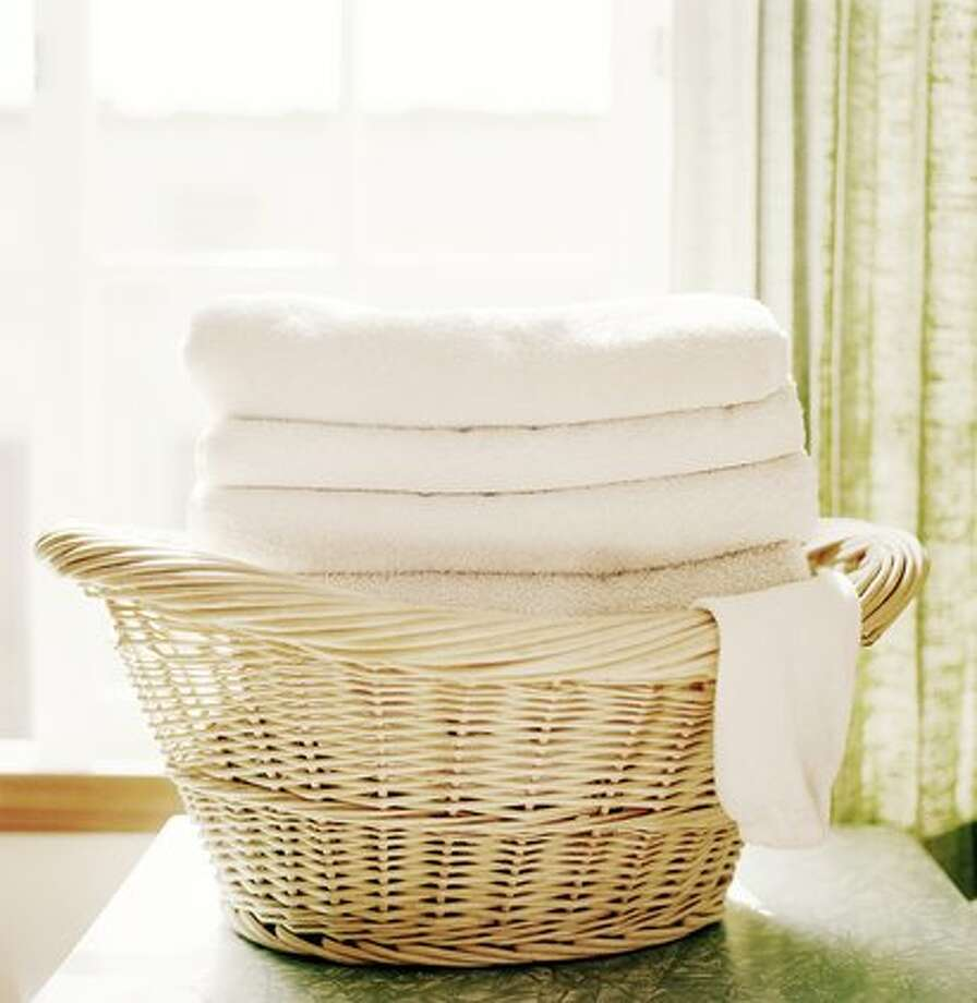 When it comes to bath towels, they need a spin in the washer after three or four uses.  To keep towels from getting musty-smelling in between washes, make sure to hang them up and give them room to air dry thoroughly. Photo: Angela Wyant, Getty Images / (c) Angela Wyant
