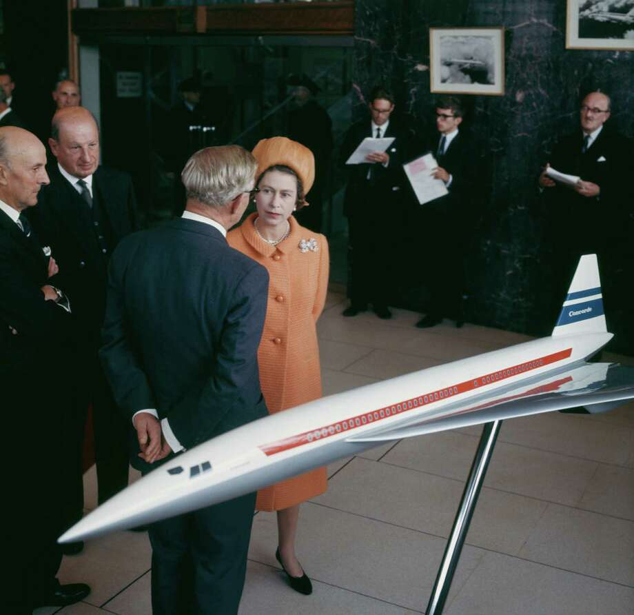 Queen Elizabeth II chats with businessmen in front of a model of the Concorde at the British Aircraft Corporation works in Filton, Bristol, on September 8, 1966. Photo: George Freston, Getty Images / 2012 Getty Images