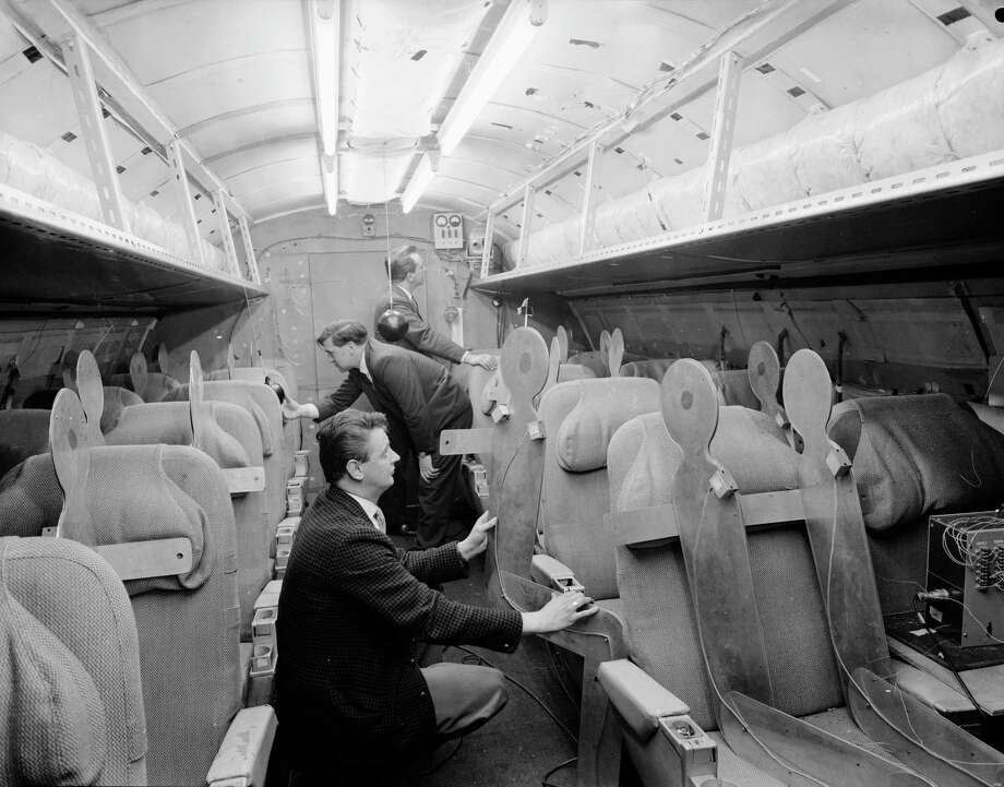 A team of designers examine a mockup of the interior of the Concorde, April 1964. Photo: Chris Ware, Getty Images / Hulton Archive
