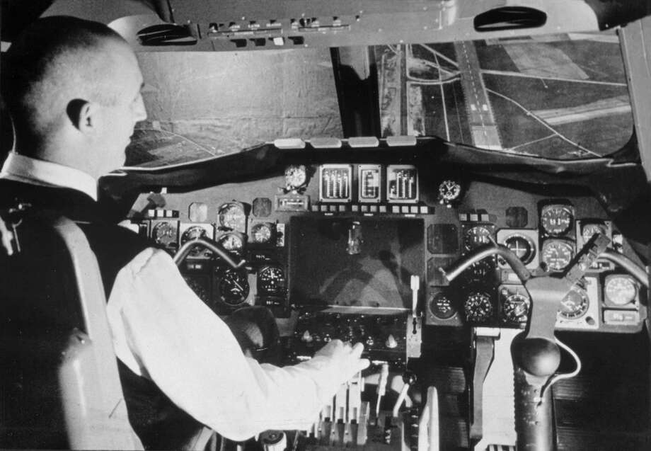 Sud Aviation chief test pilot Andre Turcat in the cockpit of a Concorde simulator in Toulouse, France, 25th May 1966. Turcat later flew the first prototype of Concorde on its maiden flight on 2nd March 1969. Photo: Manchester Daily Express, SSPL Via Getty Images / SSPL/Manchester Daily Express