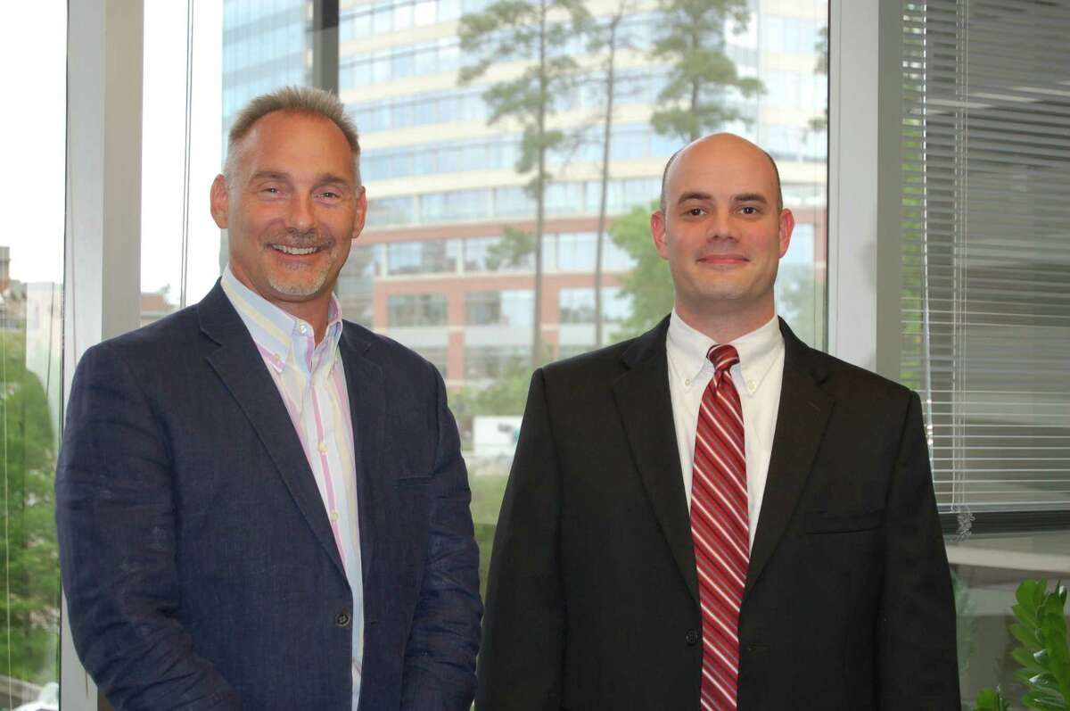 Bret L. Strong, left, founder and managing shareholder of The Strong Firm PC, welcomes Royce Lanning as an associate attorney.