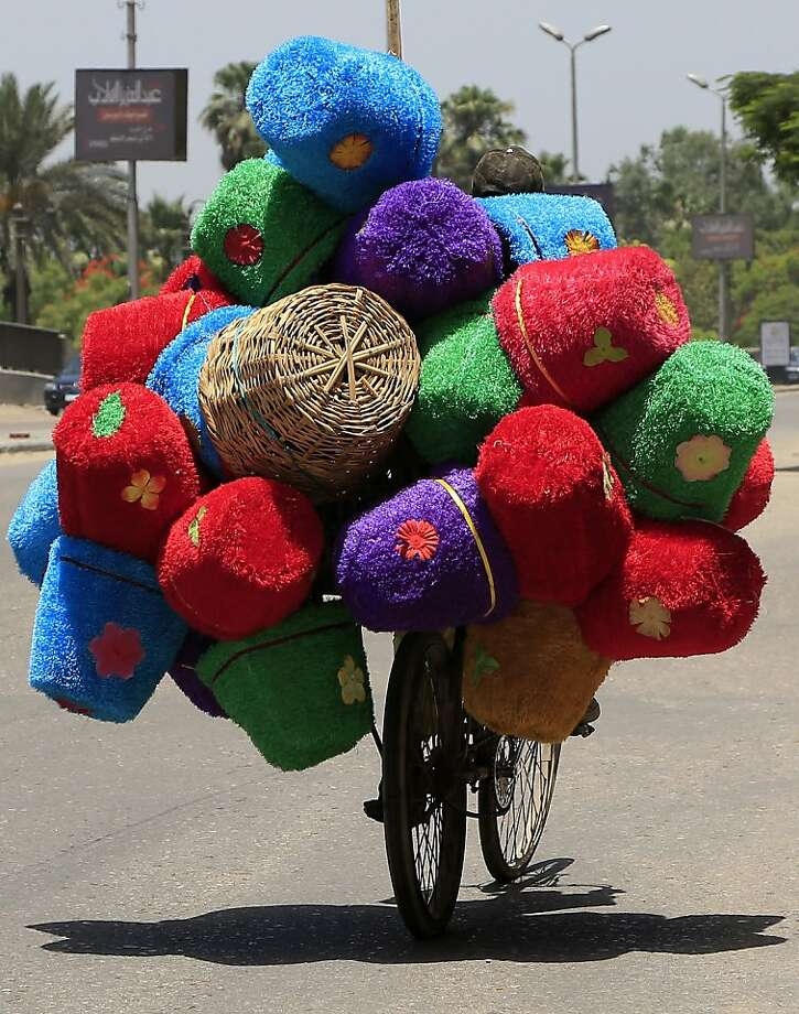 He can't see where he's going,but on the bright side, he's well-cushioned for any tumble. (Cairo.) Photo: Hassan Ammar, Associated Press
