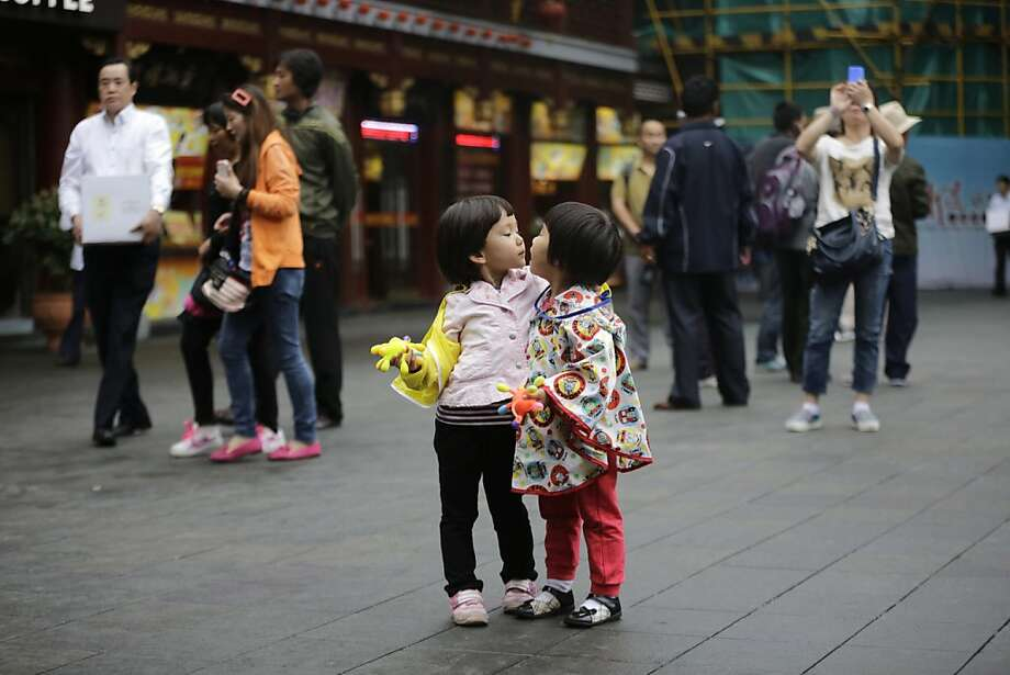 You and whose army?Two girls get in each other's face at Yuyuan Garde, a well-known tourist destination in Shanghai. Photo: Eugene Hoshiko, Associated Press