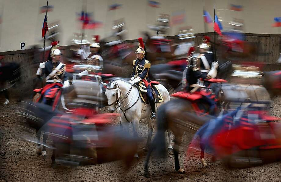 A royal welcome for Camilla: Horsemen of the French Republican Guard perform for Camilla, Duchess of Cornwall, at their headquarters in Paris. The duchess is visiting Paris on her first overseas solo engagement in support of the EMMAUS charity for the homeless, of which she is a patron. Photo: Chris Jackson, Getty Images