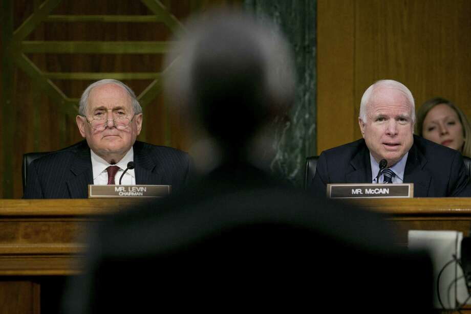 Sen. Carl Levin, D-Mich. (left), and Sen. John McCain, R-Ariz., question  Apple CEO Tim Cook, whose company has taken advantage of Ireland's low  corporate tax rate. Photo: Andrew Harrer, Bloomberg