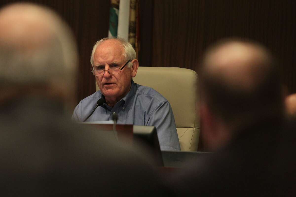 Richmond City Council Member Tom Butt asks questions of U.S. Chemical Safety and Hazard Investigation Board members during an update on the federal agency's probe into the August 6 Chevron refinery fire in Richmond, Calif. on Tuesday, Sept. 11, 2012,