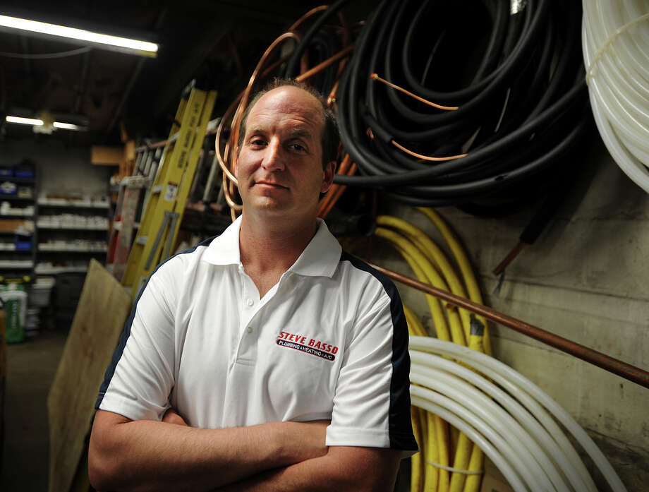 Even though he pays his employees higher than the minimum wage, Scott Basso, owner of Steve Basso Plumbing, Heating, and A/C in Bridgeport, Conn., thinks raising the wage will lead to higher supply costs. Photo: Brian A. Pounds / Connecticut Post