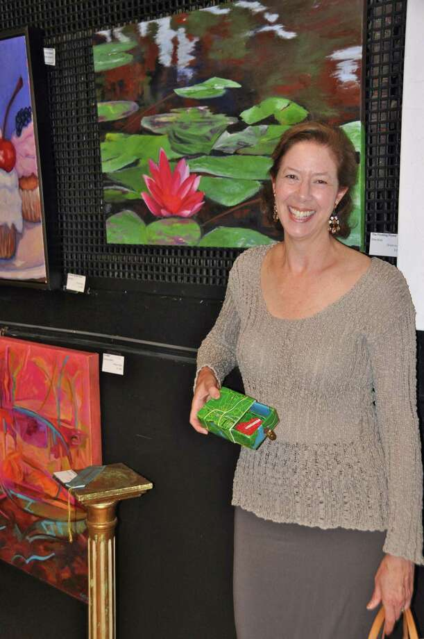 Darien Arts Center co-President Deidre Hogan invites the community to the 55th annual art show and sale, which opens on Saturday, June 1. Photo: Contributed