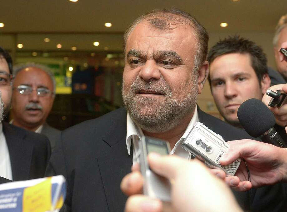 Iran's Minister of Petroleum Rostam Ghasemi talks to journalists as he arrives at a hotel for the Organization of the Petroleum Exporting Countries, OPEC, conference in Vienna, Austria, Thursday, May 30, 2012. Once the symbol of oil dominance, OPEC faces new challenges as its members gather for a ministerial meeting on how much crude to pump. For the 12 oil ministers from countries ranging from Venezuela to Nigeria and Iran, the formal focus of Friday's get-together is to determine production levels. (AP Photo/Hans Punz) Photo: Hans Punz