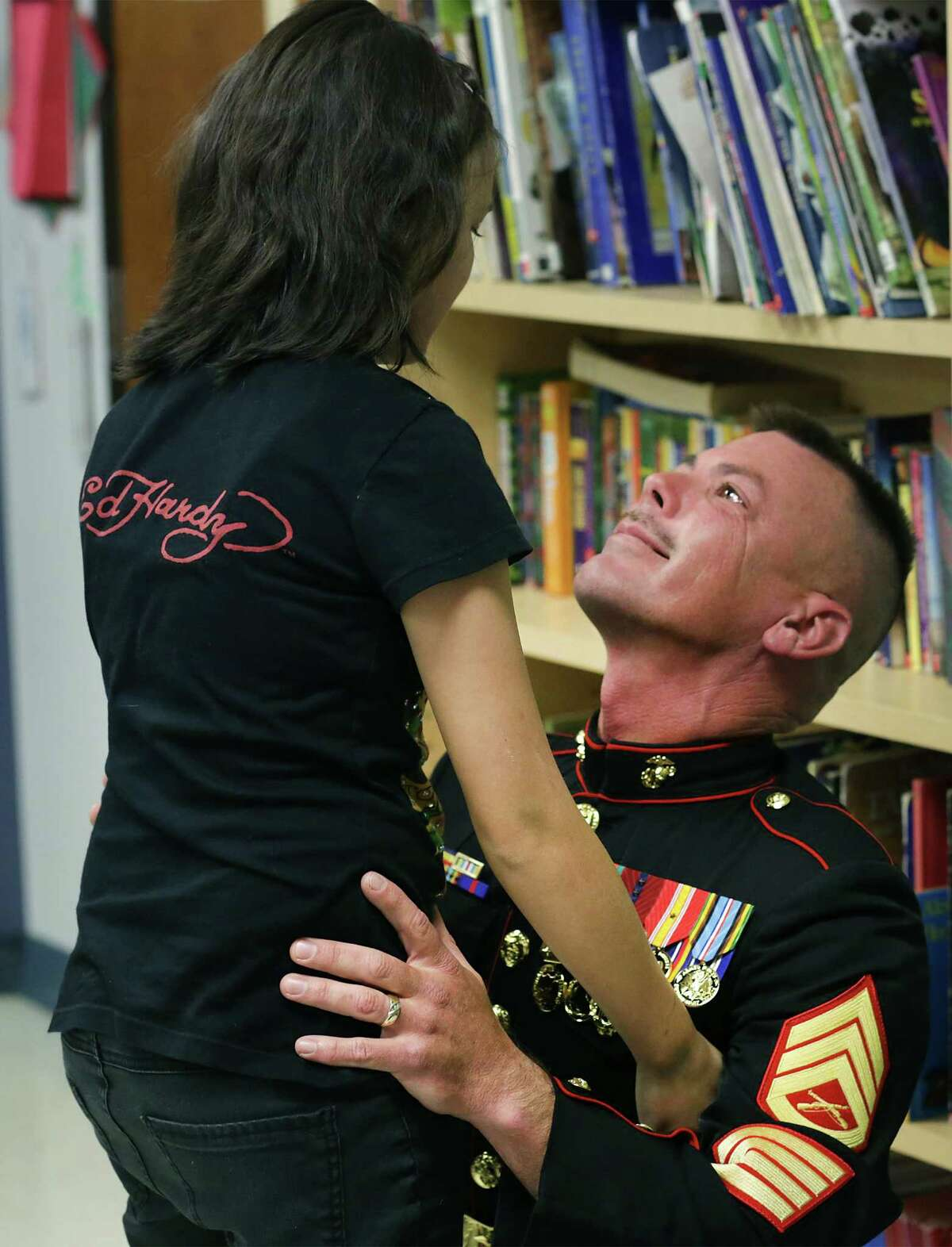 Marine Staff Sgt. Shannon Trotter, back home from Afghanistan, looks into his daughter's eyes, Alexis Trotter, as he surprises her in her fifth grade class at Wilderness Oak Elementary School on Thursday, May 30, 2013.