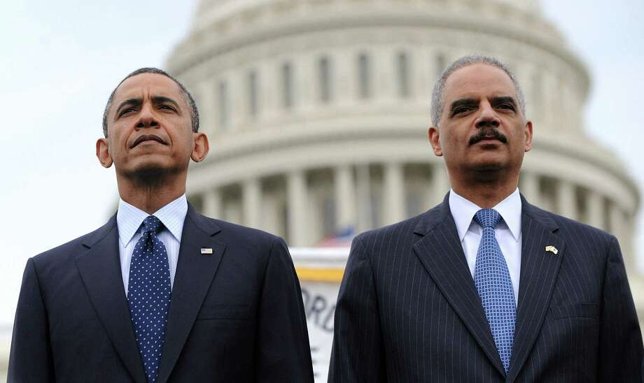U.S. Attorney General Eric Holder's legacy will be one of incompetence — and loyalty designed to please an audience of one. Photo: Oliver Douliery, Getty Images
