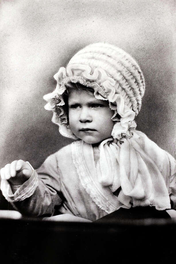 British Royalty, circa 1927, HRH Princess Elizabeth wearing a cute bonnet, the daughter of The Duke and Duchess of York. Photo: Bob Thomas/Popperfoto, Popperfoto/Getty Images / Popperfoto
