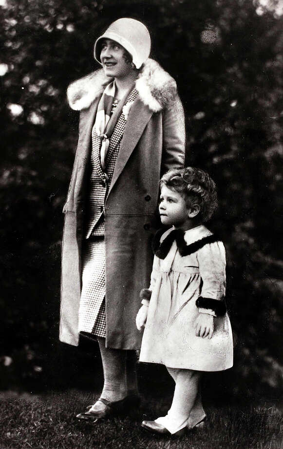 Circa 1928, HRH Princess Elizabeth, daughter of The Duke and Duchess of York pictured walking with her mother The Duchess of York. Photo: Bob Thomas/Popperfoto, Popperfoto/Getty Images / Popperfoto