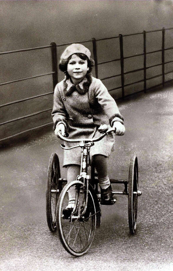 The young Princess Elizabeth is pictured riding on her tricycle, 1930. Photo: Bob Thomas/Popperfoto, Popperfoto/Getty Images / Popperfoto