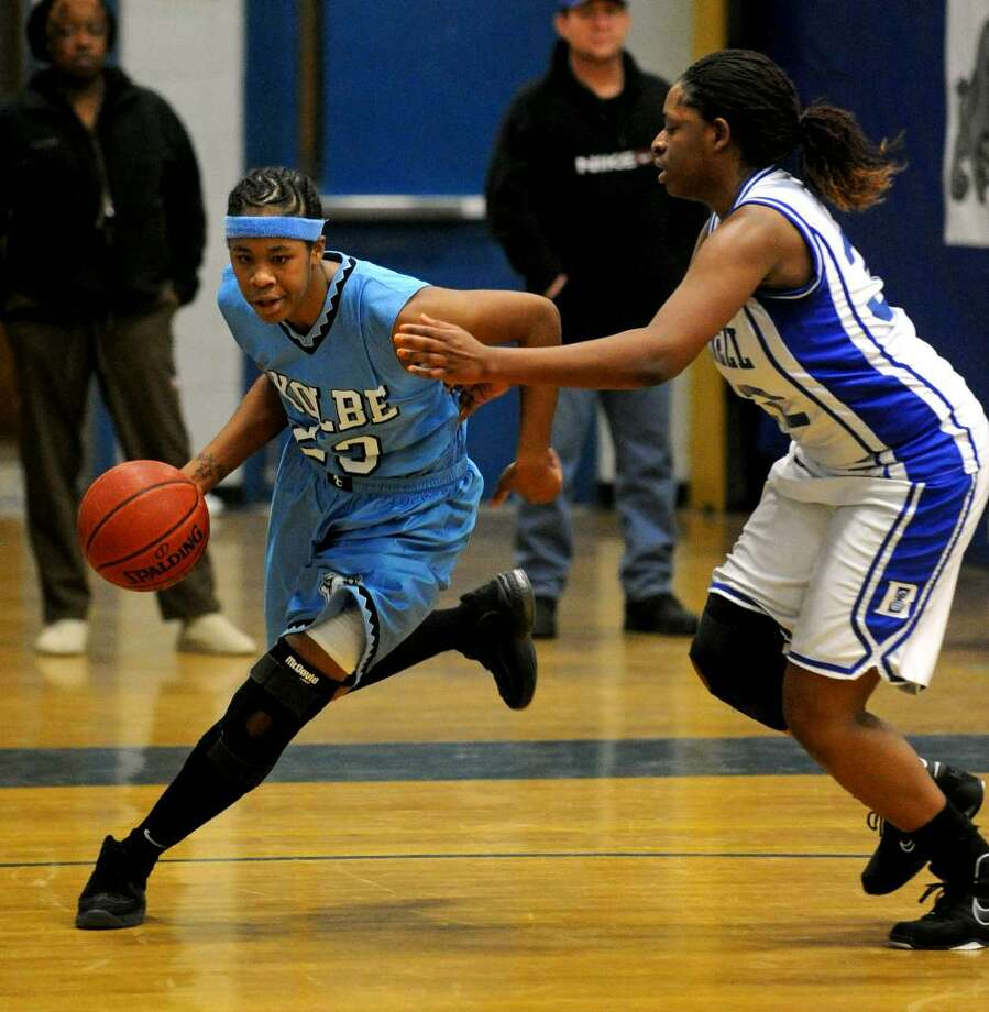 Christian Abraham/Staff photographer Kolbe's #23 Tiarrah Thompson, left, drives towards the basket as Bunnell's #32 Isnede Milfort defends, during girls basketball action in Stratford, Conn. on Tuesday Jan. 12, 2010. Photo: Christian Abraham / Connecticut Post