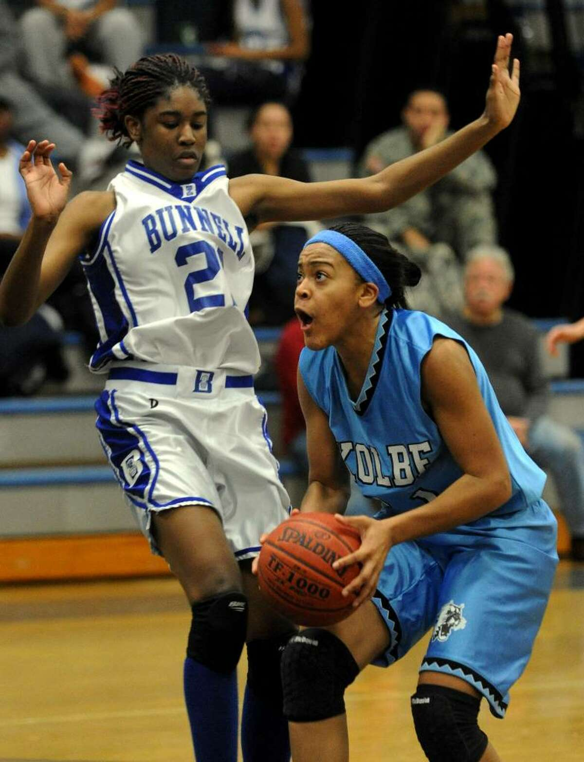 Kolbe's #31 Cherelle Moore looks to make a shot as Bunnell's #21 Shaqura Palmer defends, during girls basketball action in Stratford, Conn. on Tuesday Jan. 12, 2010.