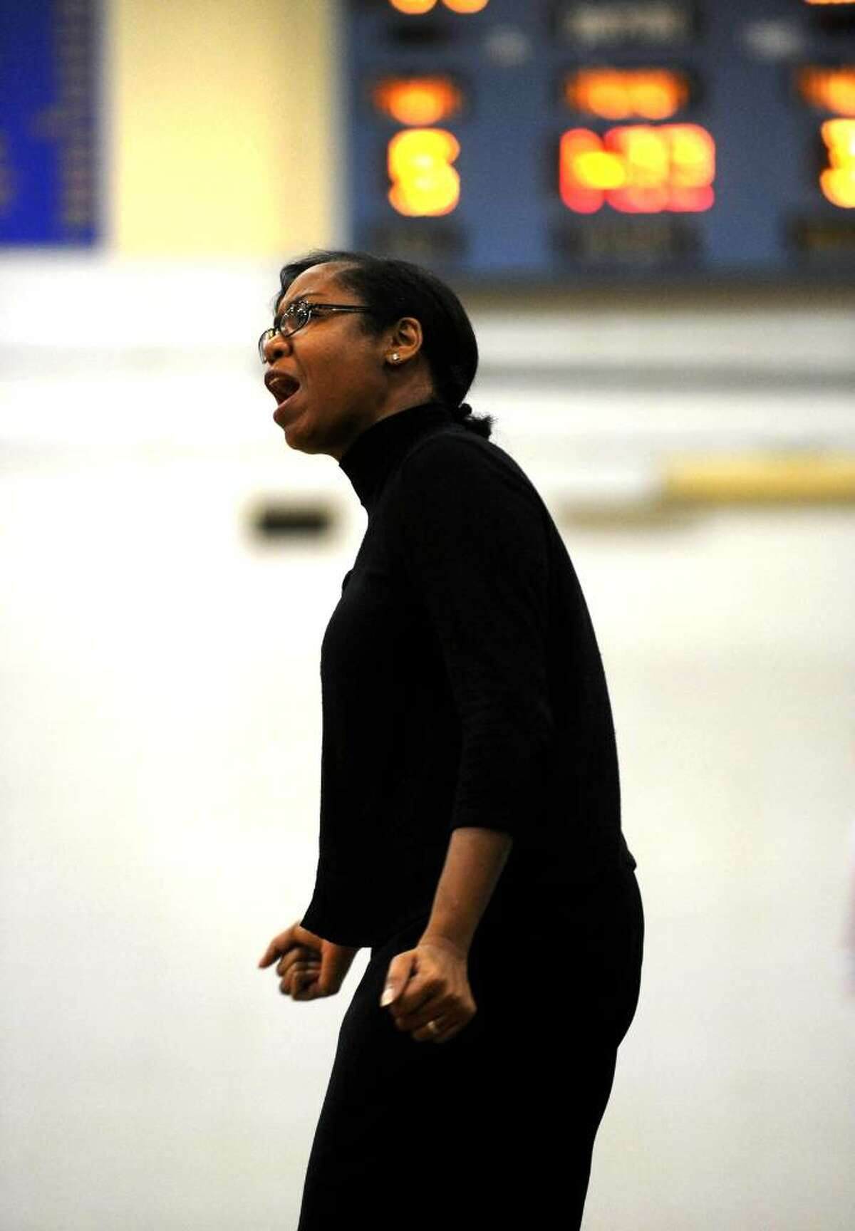 The Kolbe head coach yells instructions, during girls basketball action against Bunnell in Stratford, Conn. on Tuesday Jan. 12, 2010.