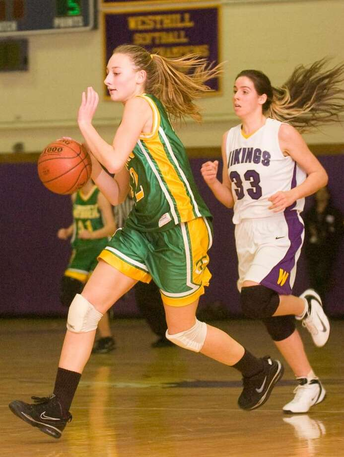 Trinity's Lauren Hurd, left, and Westhill's Ginny LaFauci, right, during and FCIAC girls basketball game at Westhill High School in Stamford, Conn. on Tuesday, Jan. 12, 2010. Photo: Chris Preovolos / Stamford Advocate