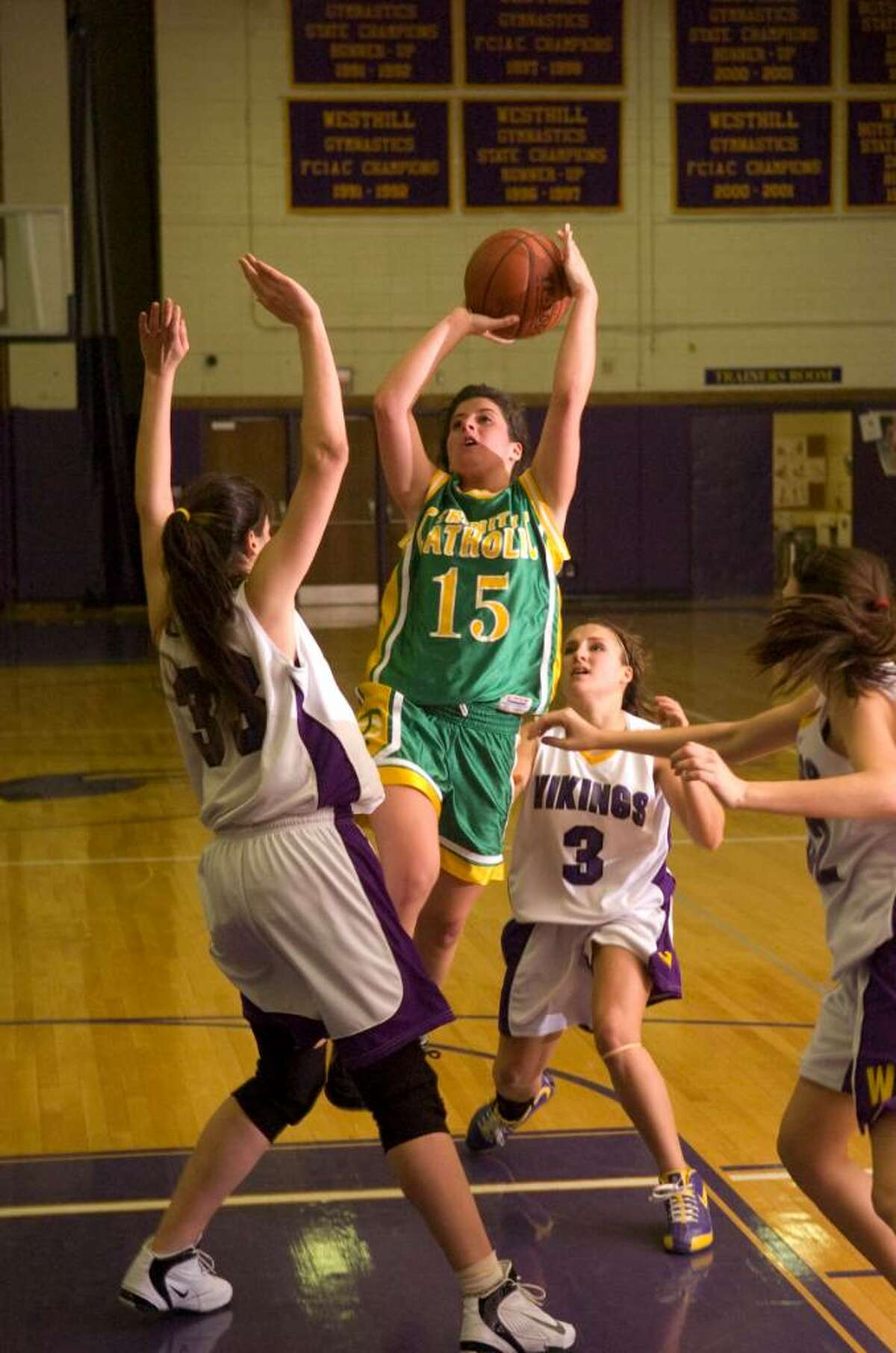 Trinity's Erin Sottosanti center, shoots during and FCIAC girls basketball game at Westhill High School in Stamford, Conn. on Tuesday, Jan. 12, 2010.