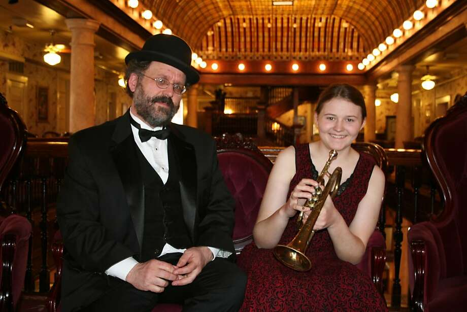 "Pianist and bandleader Rodney Sauer (shown with daughter Molly) says he ""compiles"" and performs silent film music. Photo: Mont Alto Motion Picture Orchest"
