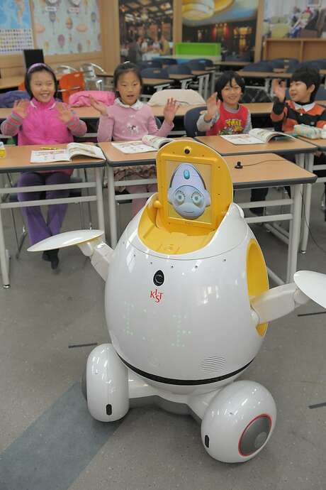 Kindergartners in South Korea get a lesson in English from Engkey, a teaching robot remotely controlled by an instructor in the Philippines to cut costs. Photo: Center For Intelligent Robotics