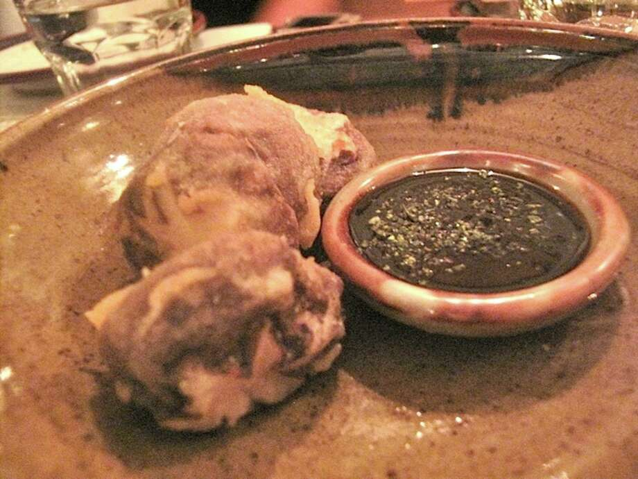 Shiitake mushroom tempura with a mushroom dipping sauce.