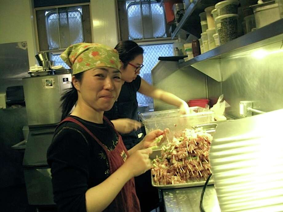 Making the yakitori negima, with koji chicken.