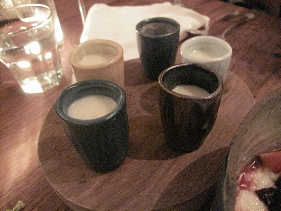 Housemade amazake, a non-alcoholic sweet fermented rice drink made with koji.