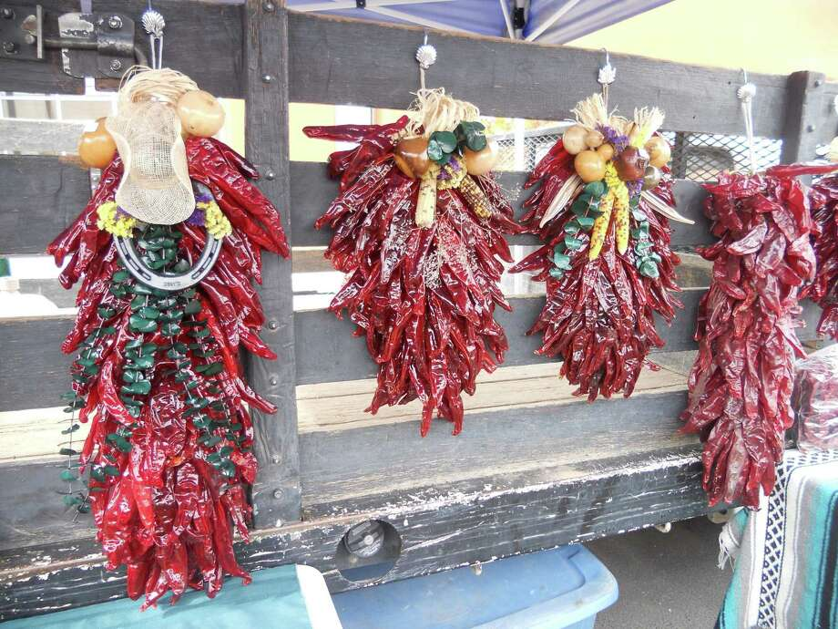 The Las Cruces Farmers and Crafts Market is a good place to find chile-related foods and décor, such as these ristras. Photo: Robin Soslow / For The Washington Post
