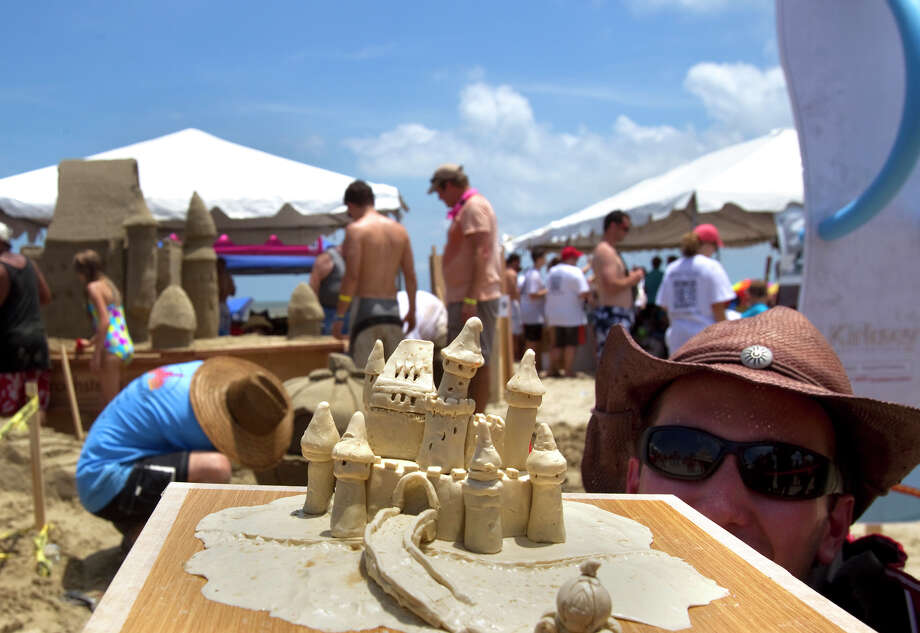 "Joe Fiala holds a sand sculpture resembling his team's aimed finished product themed ""Sanderella"" during the 26th annual AIA SandCastle Competition on Galveston's East Beach Saturday, June 2, 2012, in Galveston. Photo: Cody Duty, Houston Chronicle / © 2011 Houston Chronicle"