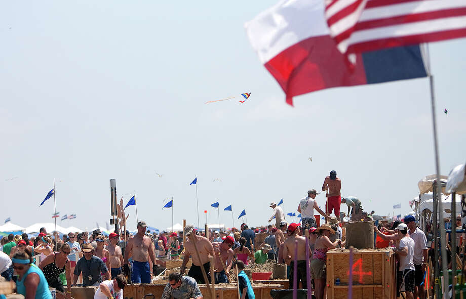 Teams work on their sand sculptures during the 26th annual AIA SandCastle Competition on Galveston's East Beach Saturday, June 2, 2012, in Galveston. The event brought out over 60 teams with the winner receiving the Gold Bucket Award. Photo: Cody Duty, Houston Chronicle / © 2011 Houston Chronicle
