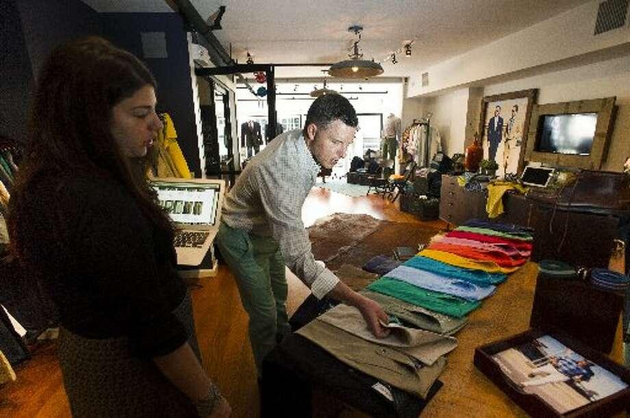 DJ Tierney shops for pants at Bonobos Guideshop  on Friday, May 17, 2013.