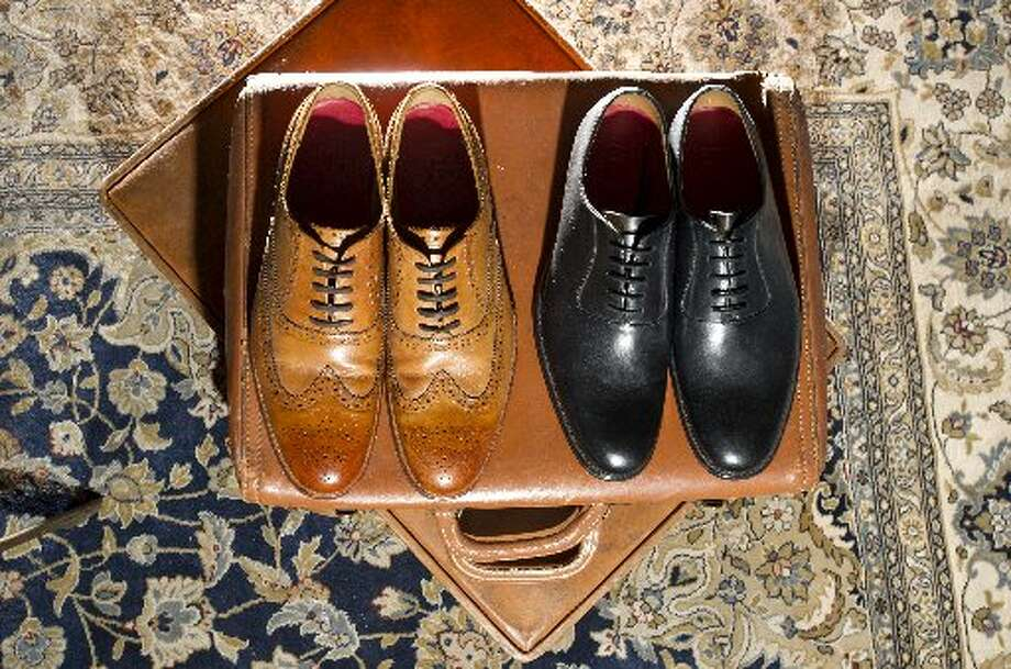 Dylan Tan Calf shoes ($335) and black Morris shoes ($375) rest on a suitcase at Bonobos Guideshop.