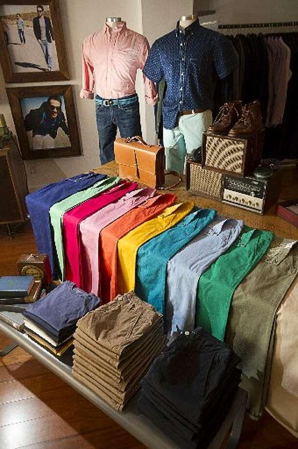 Roselands pants ($88) line a table at Bonobos Guideshop.