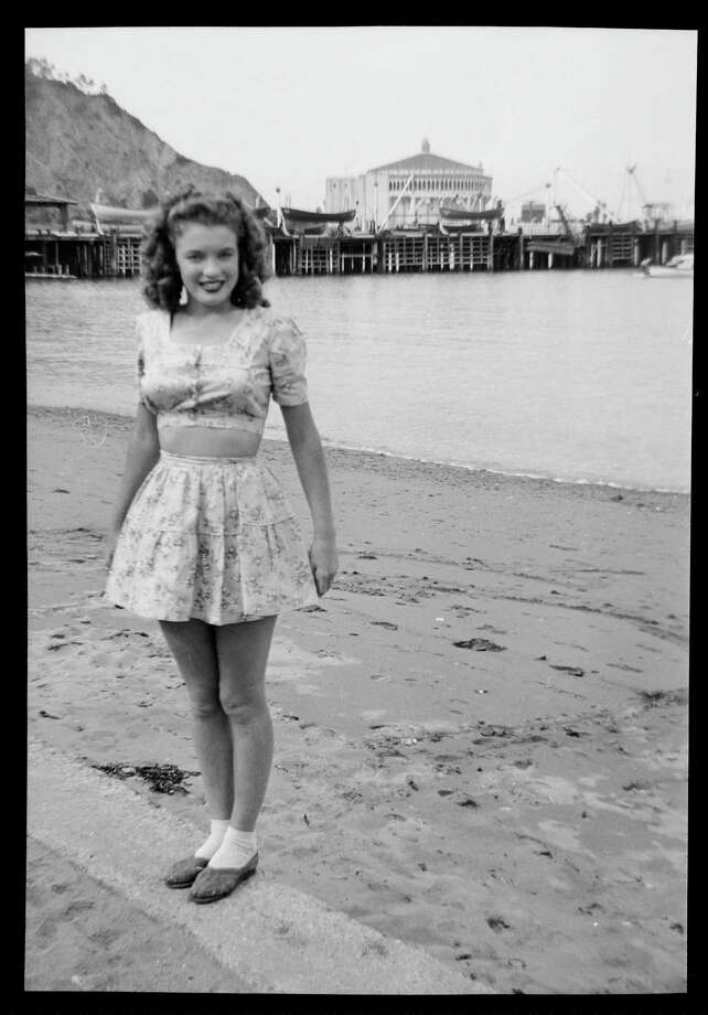 Norma Jeane Baker, future film star Marilyn Monroe (1926 - 1962), on the beach at Avalon, Santa Catalina Island, circa 1943. Her first husband James Dougherty was stationed on the island's boot camp at the time. In the background is the Avalon Casino. (Photo by Silver Screen Collection/Hulton Archive/Getty Images) Photo: Silver Screen Collection, Multiple / 2006 Getty Images