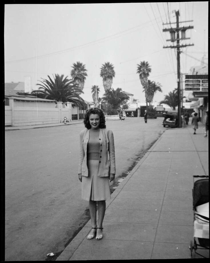 Norma Jeane Baker, future film star Marilyn Monroe (1926 - 1962), standing in the street in a smart outfit, circa 1941. (Photo by Silver Screen Collection/Hulton Archive/Getty Images) Photo: Silver Screen Collection, Multiple / 2006 Getty Images