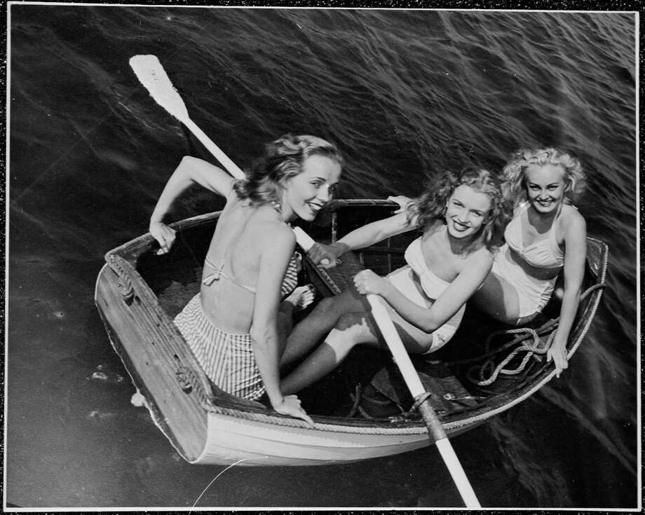 Norma Jeane Baker (centre), future film star Marilyn Monroe (1926 - 1962), out rowing with a couple of friends, circa 1941. (Photo by Silver Screen Collection/Hulton Archive/Getty Images) Photo: Silver Screen Collection, Multiple / 2006 Getty Images