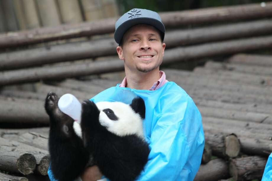 Brian Littrell of Backstreet Boys holds a giant panda at the Giant Panda Breeding Research Institute during their China Tour on May 30, 2013 in Chengdu, Sichuan Province of China. (Photo by ChinaFotoPress/ChinaFotoPress via Getty Images)