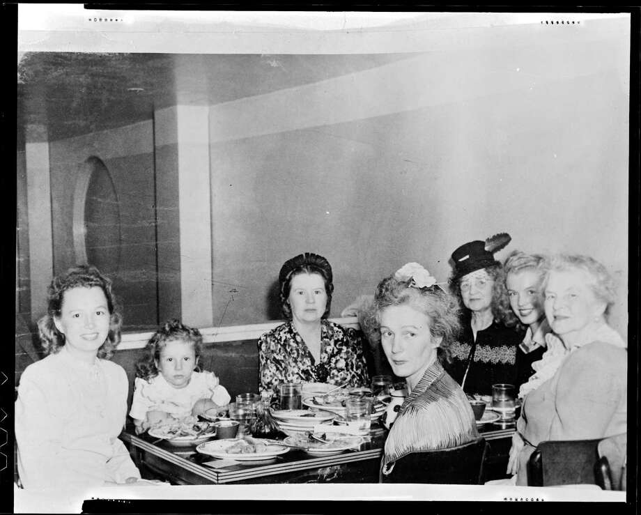 Norma Jeane Baker, future film star Marilyn Monroe (1926 - 1962), at a Chinese restaurant with members of her family, circa 1942. (Photo by Silver Screen Collection/Hulton Archive/Getty Images) Photo: Silver Screen Collection, Multiple / 2006 Getty Images