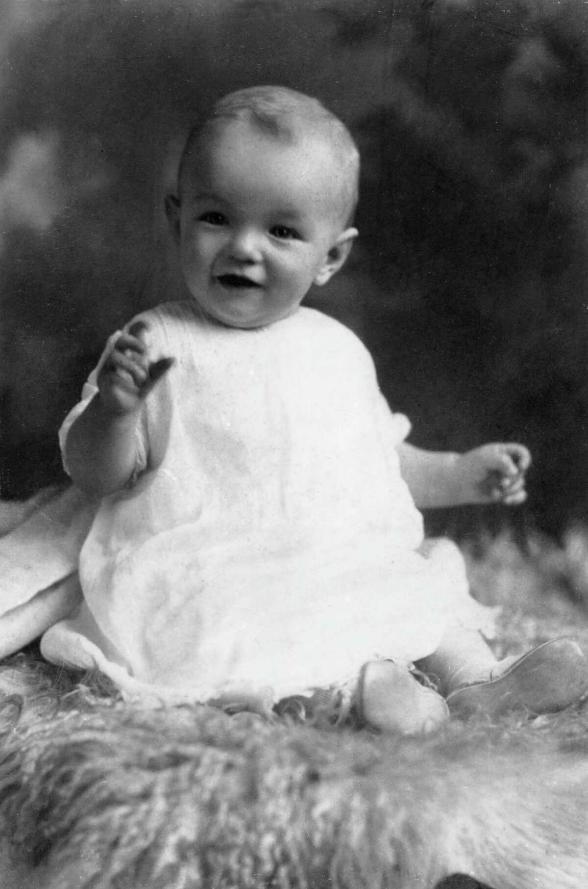 circa 1927: Studio portrait of American actor Marilyn Monroe (born Norma Jean Mortenson, 1926 - 1962) at the age of six months, sitting on a woolly rug in a white smock. (Photo by Hulton Archive/Getty Images)