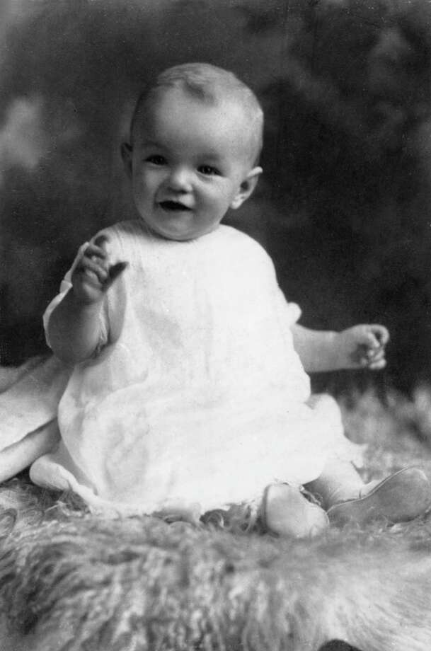 circa 1927:  Studio portrait of American actor Marilyn Monroe (born Norma Jean Mortenson,  1926  - 1962) at the age of six months, sitting on a woolly rug in a white smock.  (Photo by Hulton Archive/Getty Images) Photo: Hulton Archive, Multiple / Archive Photos