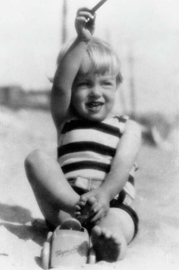 A portrait of American actor Marilyn Monroe (born Norma Jean Mortenson ,1926  - 1962) as a young child, playing on a beach in a striped bathing suit.  (Photo by Archive Photos/Getty Images) Photo: Hulton Archive, Multiple / Archive Photos