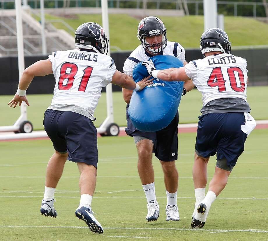 Week 2 Ryan Griffin (center) Owen Daniels and Tyler Clutts work on a blocking drill during Thursday's OTA at the Methodist Training Center.
