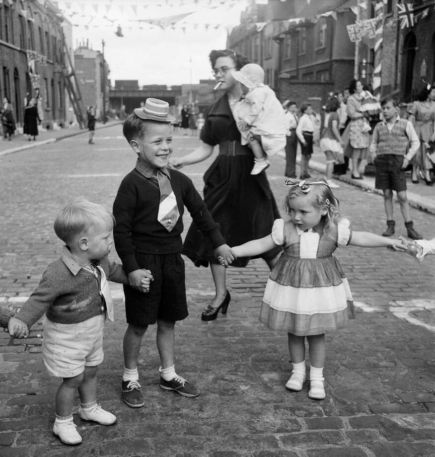 Children dance at a street party at Morpeth Street, in London's East End, to celebrate the coronation of Queen Elizabeth II. Photo: Thurston Hopkins, Getty Images / Hulton Royals Collection
