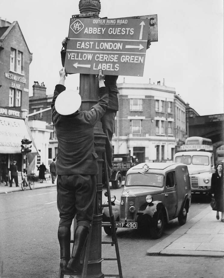 RAC (Royal Automobile Club) Signal Officers erecting a route sign in preparation for the coronation of Queen Elizabeth II, at the junction of Queenstown Road and Battersea Park Road, London, 22nd May 1953. Photo: Harry Todd, Getty Images / 2013 Getty Images