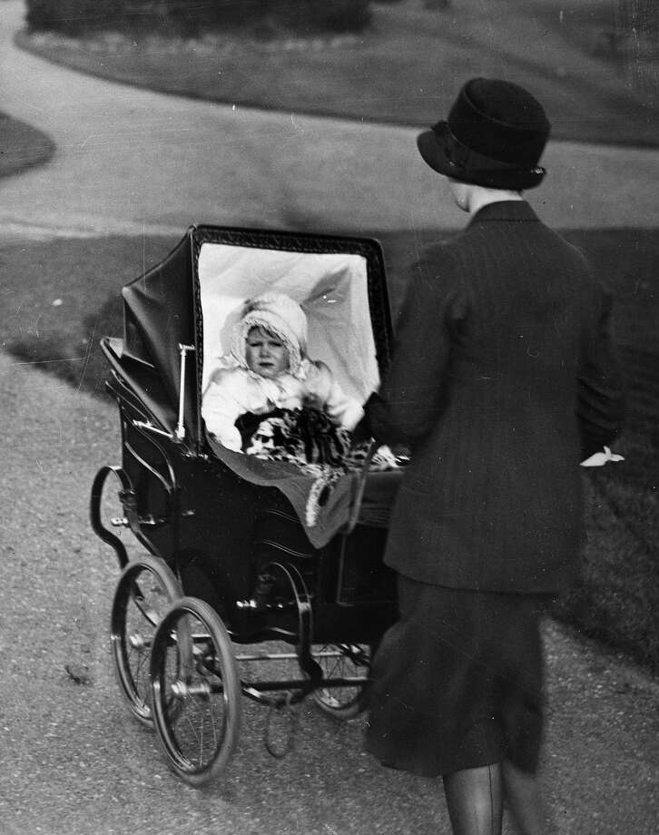 Princess Elizabeth sitting in a pram in 1928. Photo: Central Press, Getty Images / Hulton Royals Collection